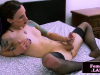 Tattooed tgirl in black stocking masturbates